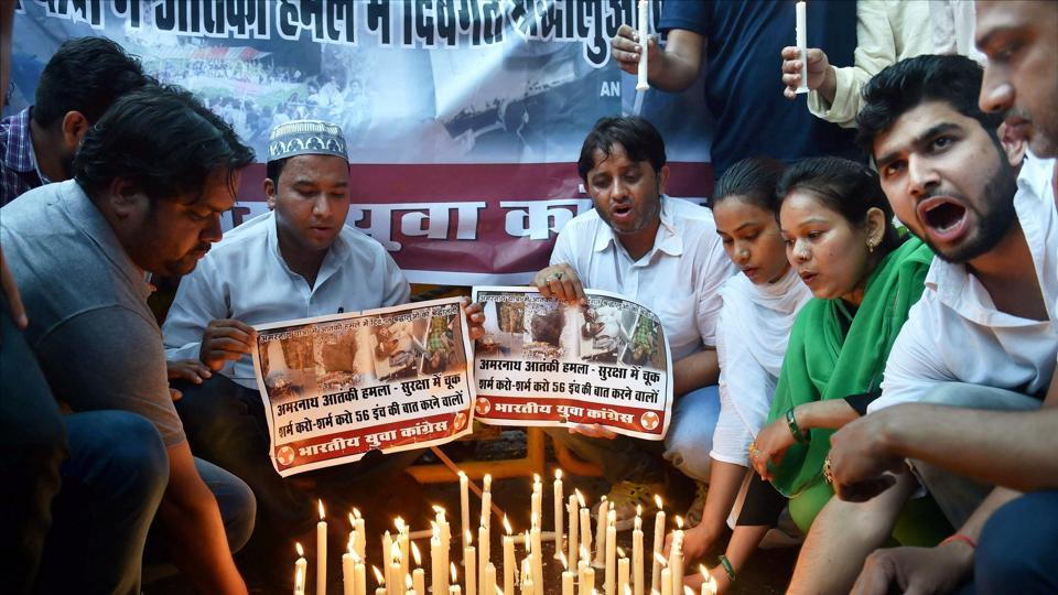 Youth Congress activists hold placards and light candles during a protest to condemn the attack on a bus during the Amarnath Yatrs, in New Delhi.