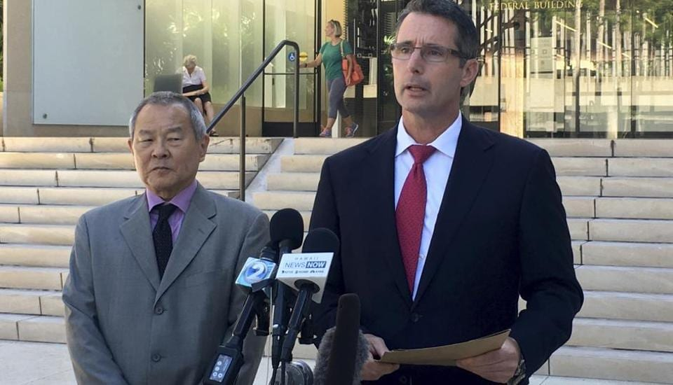 Paul Delacourt, the FBI special agent in charge of the Hawaii bureau, right, speaks at a news conference as Acting United States Attorney Elliot Enoki, left, listens outside federal court in Honolulu, Monday, July 10, 2017.