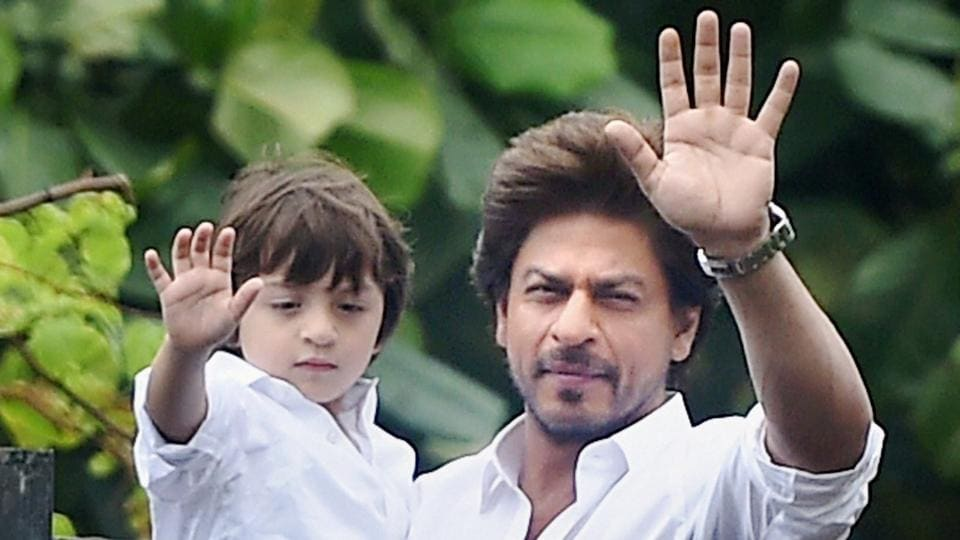Bollywood actor Shah Rukh Khan along with son Abram greets his fans on the occasion of Eid at his residence in Mumbai on Monday.