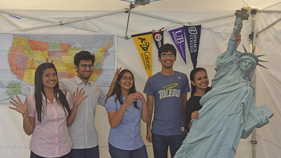 Students celebrate as they get their visa to study in USA during student visa day at US Consulate general in Mumbai on June 8.