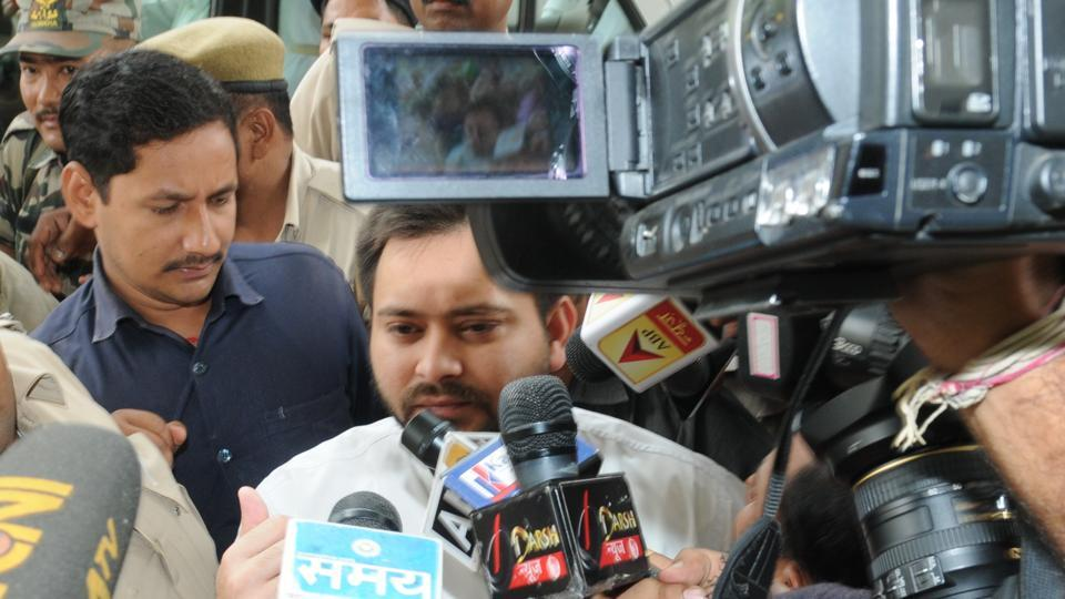 Deputy Chief Minister Tejashwi Prasad Yadav surrounded by mediapersons, in Patna, on Wednesday.