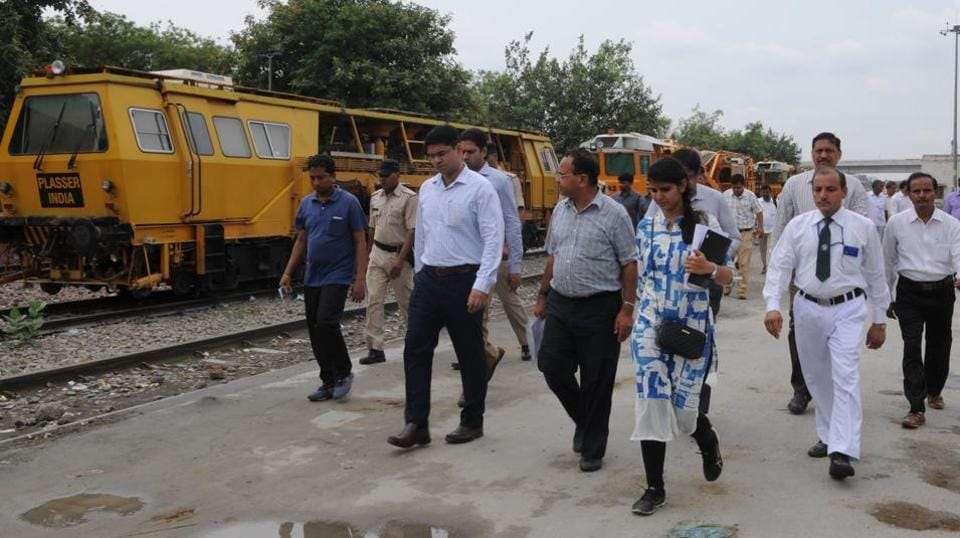 Deputy commissioner Vinay Pratap Singh (second from left) at the Gurgaon railway station with other officials.