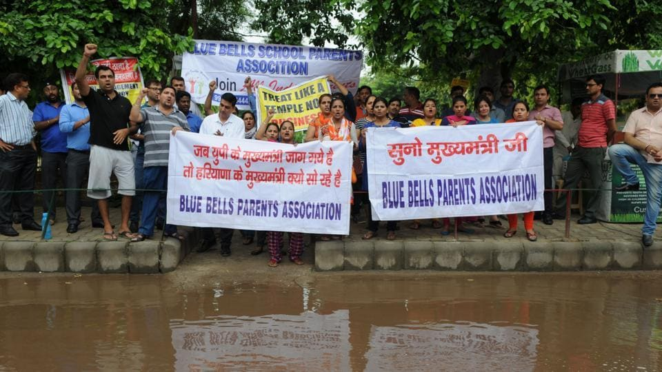 Parents of children studying in Blue Bells Model School in Sector 4 protest outside the school premises against development charges and increase in fee, on Wednesday.