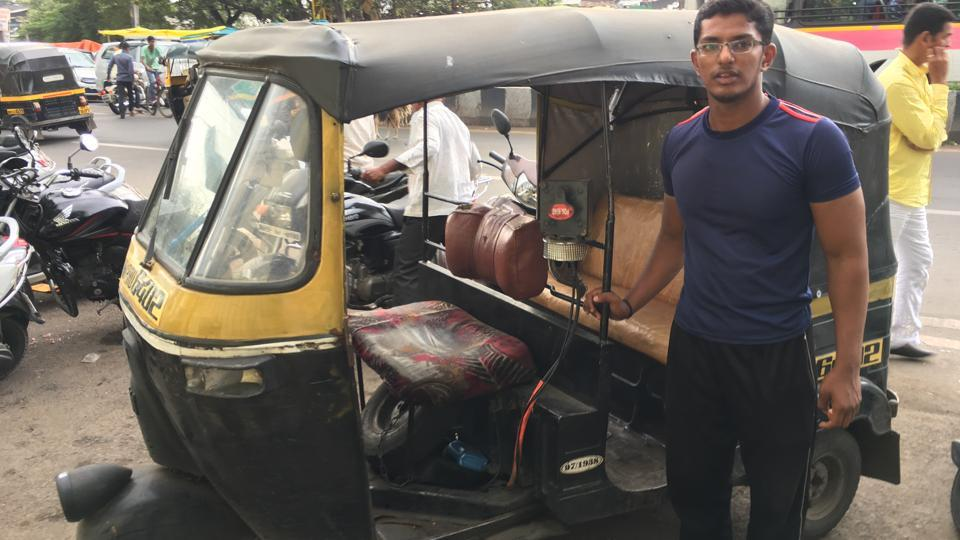 Saurabh Karde poses with the rickshaw which he alerted the police to as being the vehicle carrying beef.