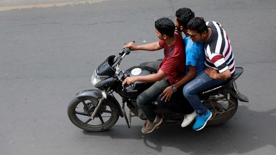 Three people travelling on a bike in Pune on Tuesday. This is a very common practise in the city and is a disaster waiting to happen.