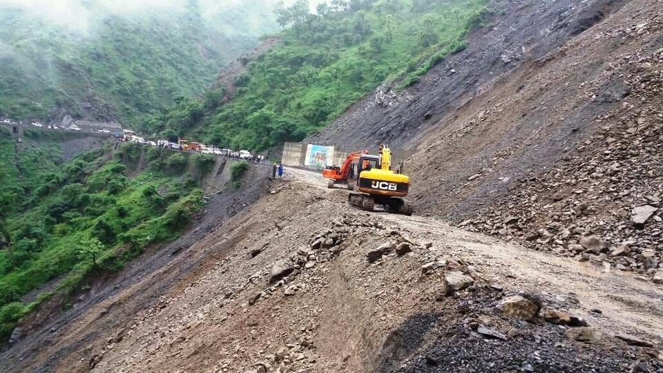 Landslides like this one in Kalsi often hold up traffic for several days in the hilly areas.