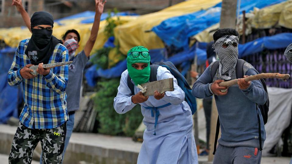 A shift in the patterns of violence in Kashmir has been witnessed in the past one year. After the death of Hizbul militant Burhaan Wani, Kashmir valley plunged into crisis. At least 90 people were killed and 1,000 wounded during the ensuing unrest with security forces taking to pellet guns for crowd control. Thousands of police personnel and security forces dotted the roads and villages of the valley to prevent the aftermath. Young boys first took to throwing stones in mass protests during the 2008 uprising. Since then, it has become a popular way for youths to express their anger against the government and authorities in the valley. (Cathal McNaughton / REUTERS)