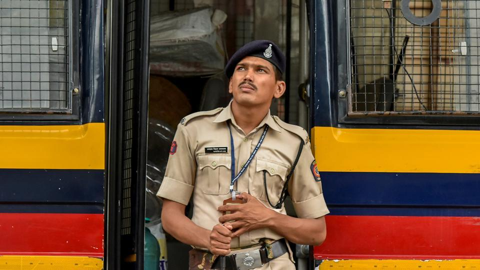 A police constable watches the broadcast. (Kunal Patil/HT Photo)