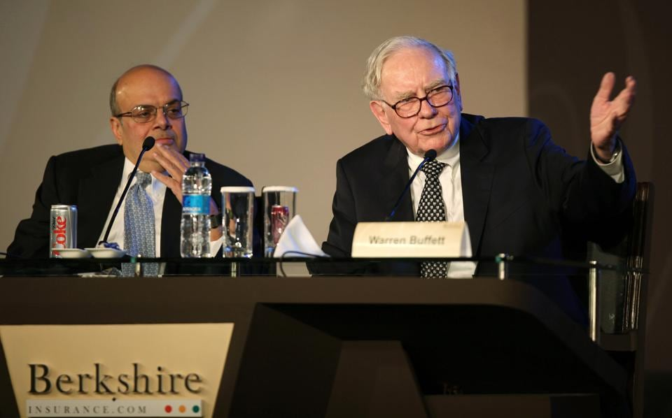 Warren Buffett, chairman and chief executive officer of Berkshire Hathaway Inc with Ajit Jain (left), president of the reinsurance division.