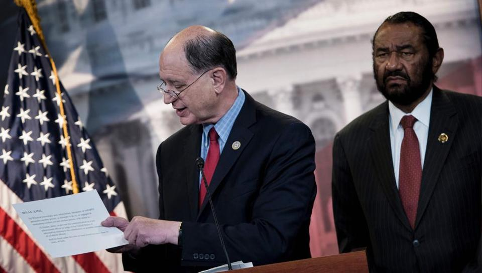 Brad Sherman (left) and Al Green take questions about articles of impeachment against US President Donald Trump at a press conference in Washington.