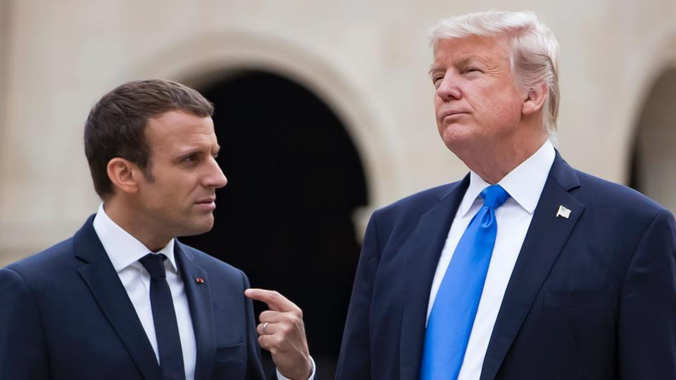 French President Emmanuel Macron (left) and US President Donald Trump talk as they leave the Army Museum at Les Invalides in Paris.