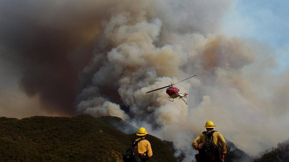 Los Padres National Forest firefighters watch as helicopters work on the northeast flank of the Whittier fire near Hot Spring Canyon outside Cachuma Lake. (REUTERS)