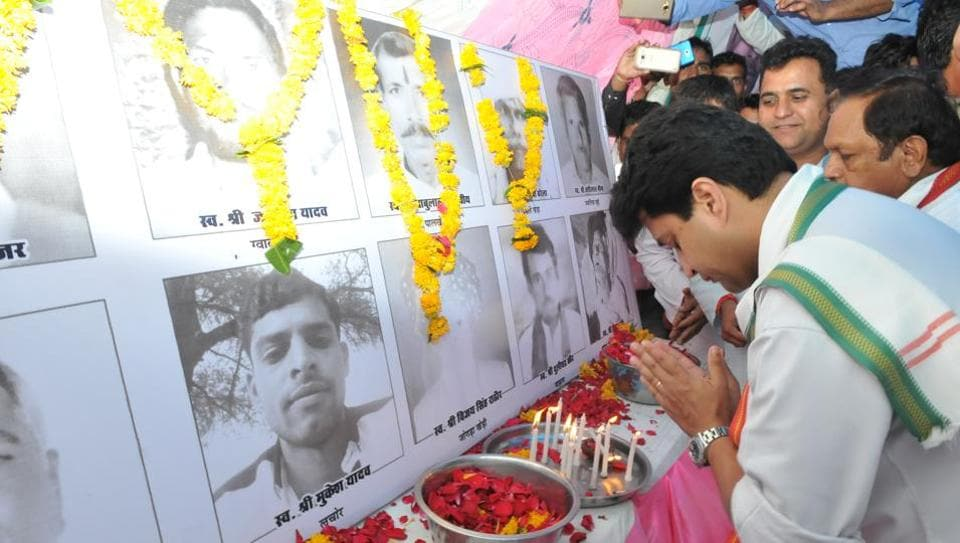 Congress leader Jyotiraditya Scindia paying respect to farmers who committed suicide at a condolence meet in Sehore, on July 13, 2017.