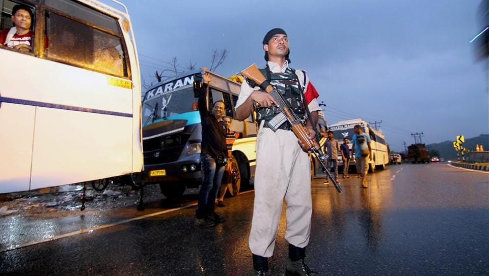 A paramilitary jawan keeps vigil as a convoy of Amaranth pilgrims leave for Kashmir from Jammu on Tuesday.