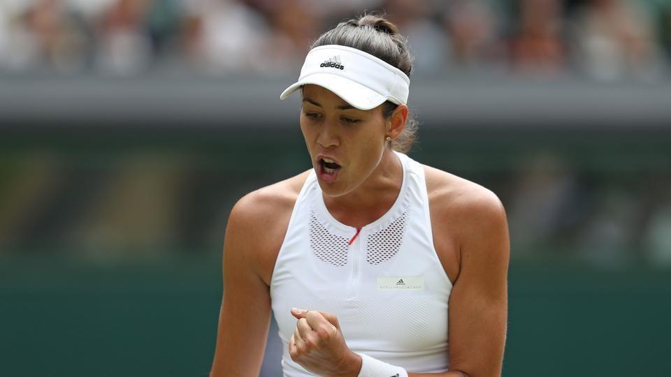 Spain's Garbine Muguruza reacts after winning her women' singles semi-final against Slovakia Magdalena Rybarikova at Wimbledon 2017 at The All England Lawn Tennis Club onThursday.