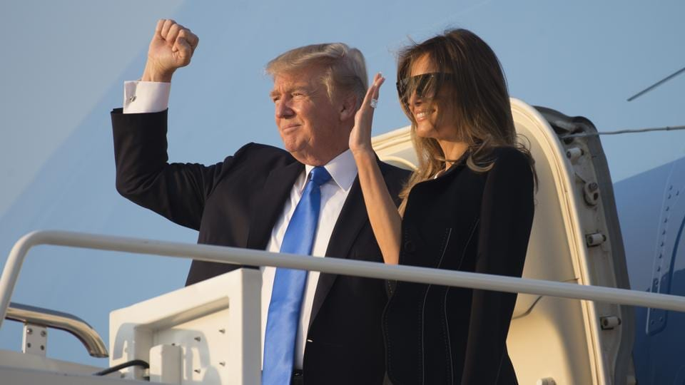 US President Donald Trump and First Lady Melania Trump board Air Force One prior to departure from Andrews Air Force Base in Maryland as they travel to Paris, France.