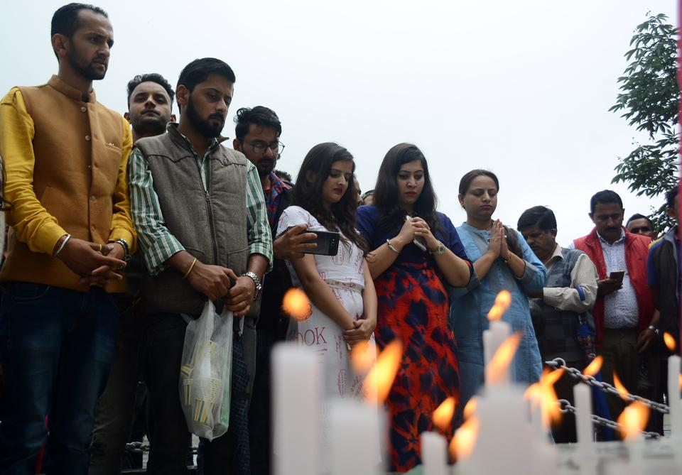 Shimla residents lighting candles in solidarity with the minor who was raped and murdered.