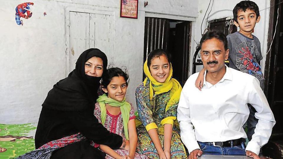 Pakistani bride Tahira Ahmad with her husband, Chaudhary Maqbool Ahmad, and their children at Qadian in Punjab.