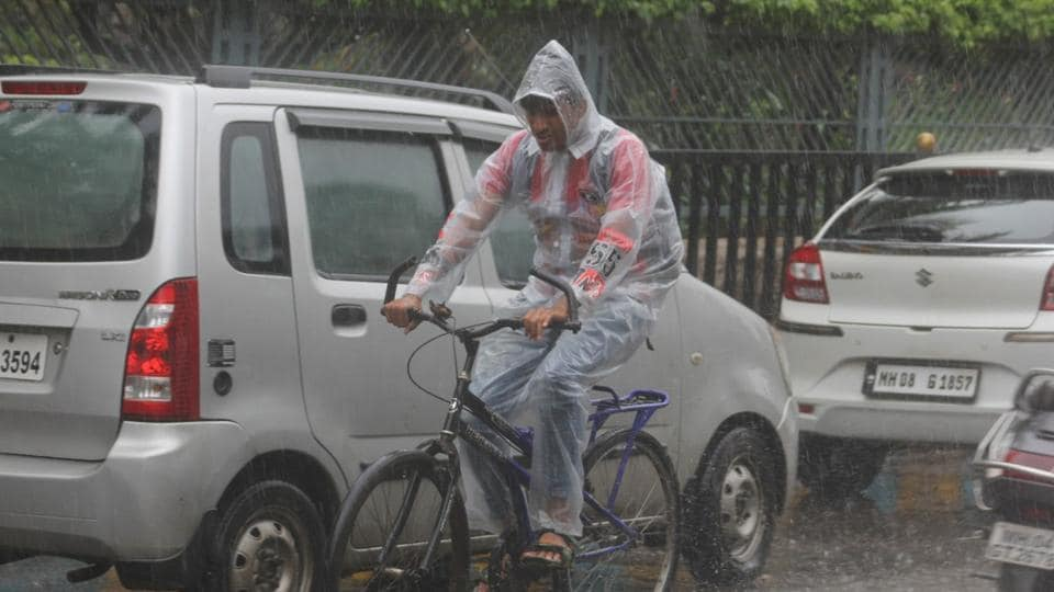 A man braves the rain in Mumbai on Friday.