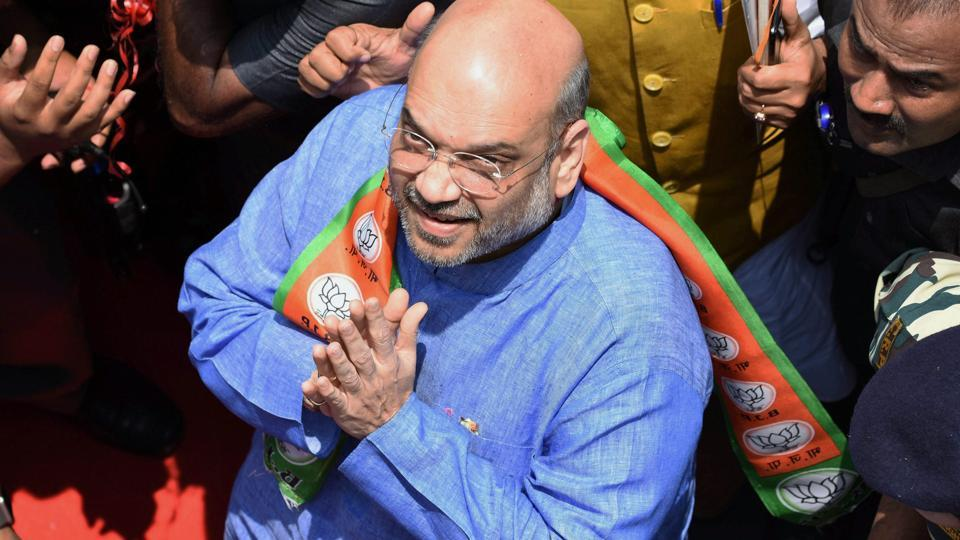 BJP national president Amit Shah being welcomed by party workers at a function in New Delhi.