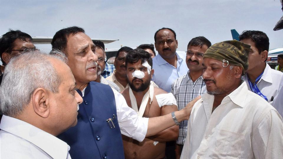 Gujarat Chief Minister Vijay Rupani and his deputy Nitin Patel with Salim Sheikh, the driver of the bus attacked by militants in Jammu and Kashmir.