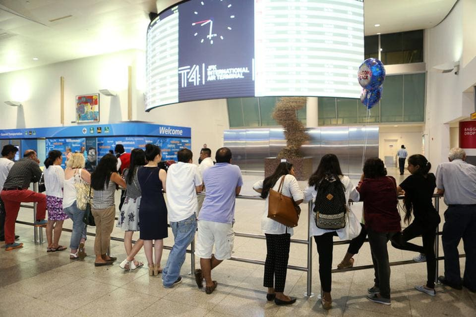 People wait at the arrival hall of the John F Kennedy International Airport  in New York.