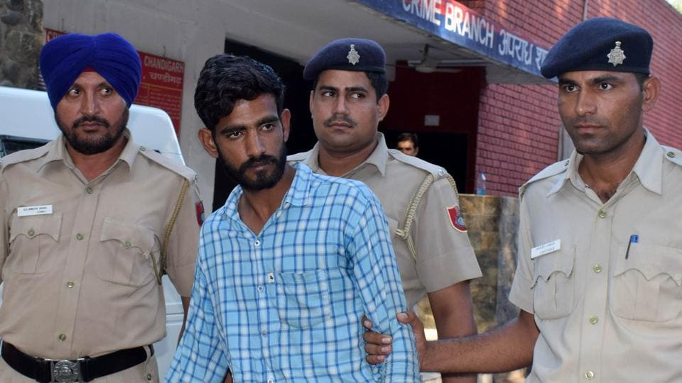 Ajay Kumar, alias Ajju, in the police custody inChandigarh on Thursday.