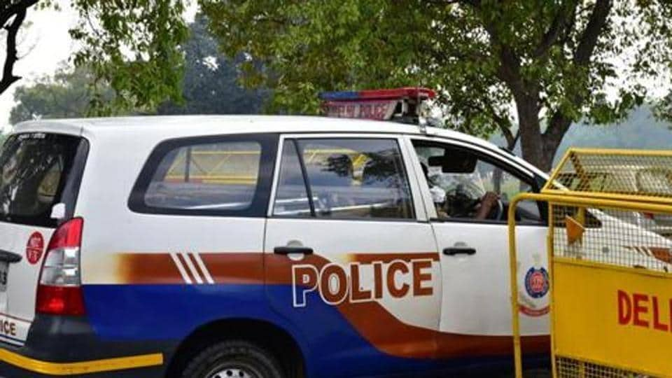 A woman gave birth to a baby in a police vehicle on Friday.