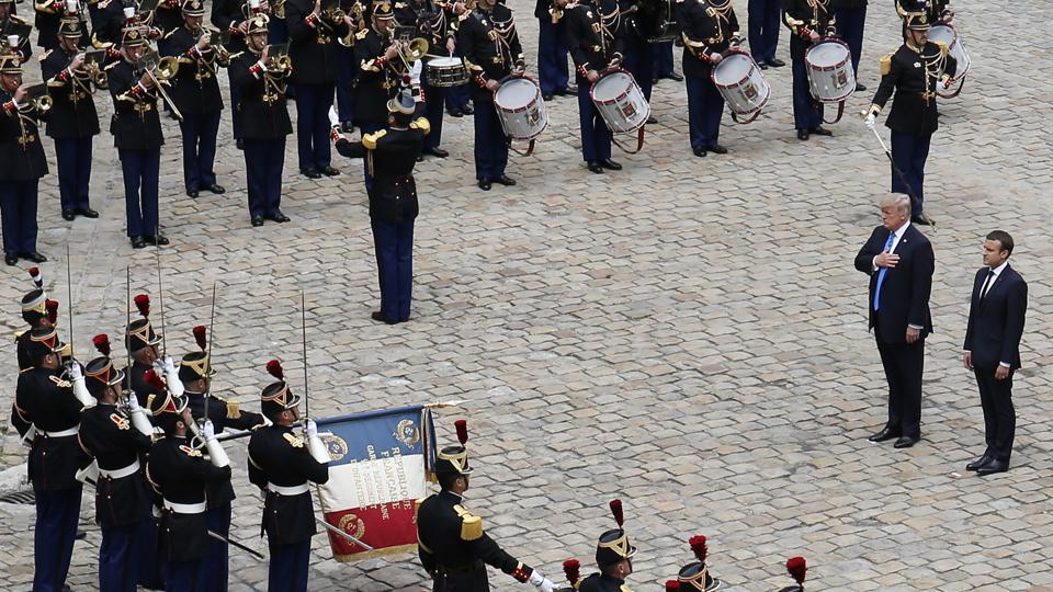 Emmanuel Macron and Donald Trump attend a welcoming ceremony and inspection of the guards at the Les Invalides in Paris, France. Trump appeared enthused by the military display, having described himself on an earlier occasion as a 'big military person'. (Matthieu Alexandre / AP)