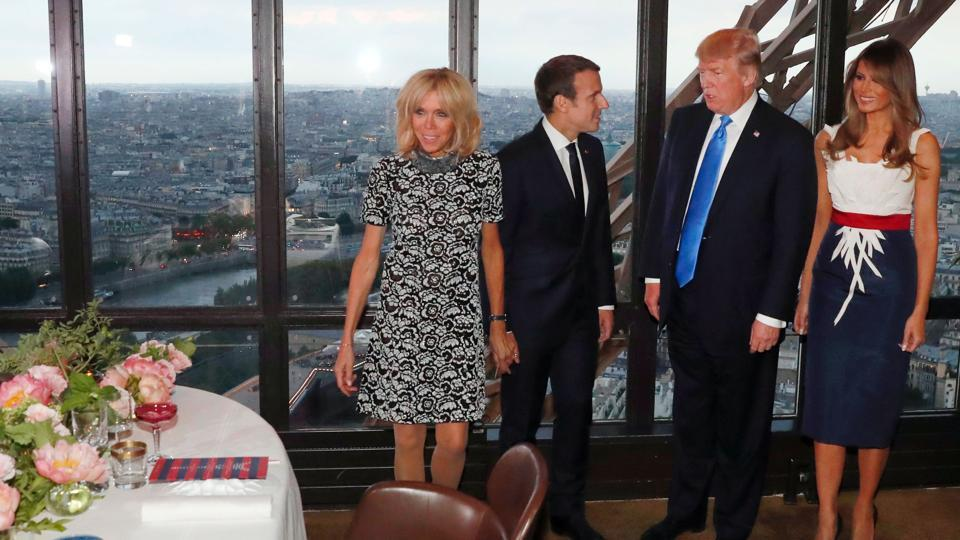 (French President Emmanuel Macron (2nd L), his wife Brigitte Macron (L), US President Donald Trump (2nd R) and his wife Melania Trump (R) arrive ahead of a dinner at Le Jules Verne Restaurant on the Eiffel Tower in Paris, on Thursday.