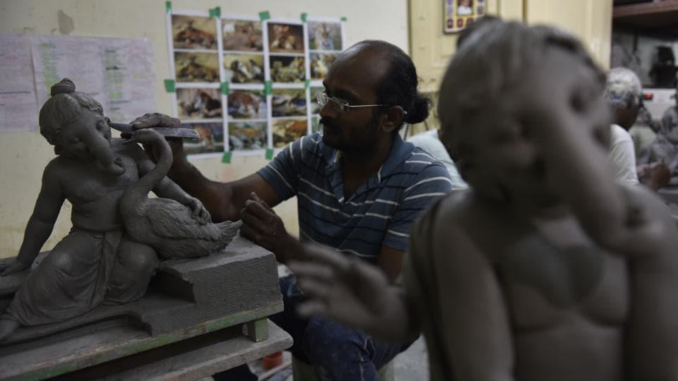 Ganesh idols being readied at a workshop in Mumbai.