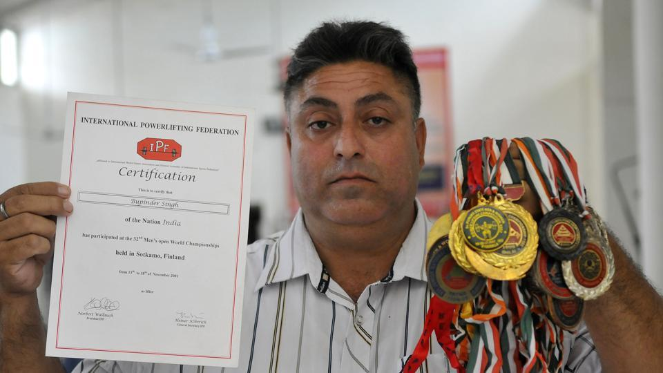 Bhupinder Singh with his medals and certificates in Ludhiana on Thursday.