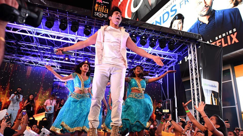 Varun Dhawan performs on stage during the IIFA Stomp in Times Square. (AFP)