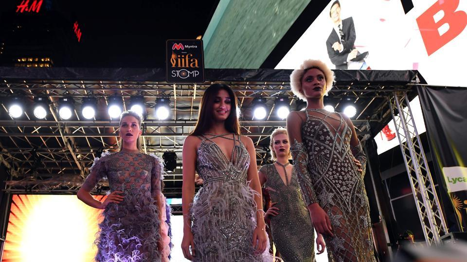 Disha Patani (C) and other models present outfits during the IIFA Stomp in Times Square. (AFP)