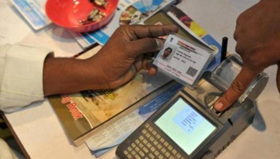 A man registers his fingerprint linked with his Aadhaar number.