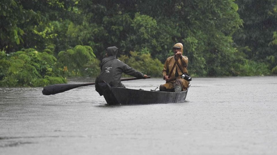 Indian forest guards seen out on patrol on a boat at Kaziranga National Park, about 250 kilometres east of Guwahati. (Biju BORO / AFP)