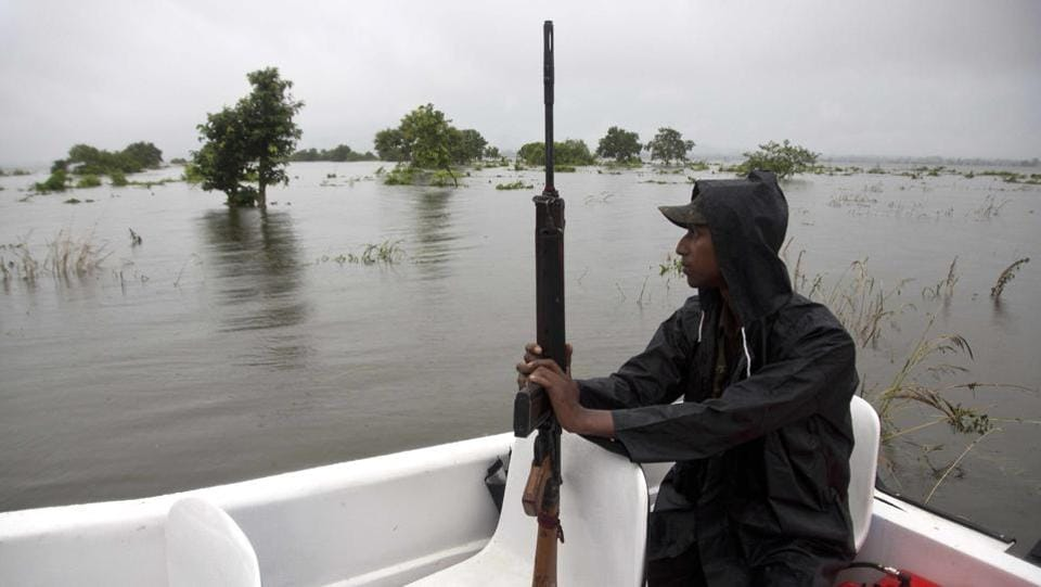 A forest guard patrols in a speed boat as the risk of poaching increases during floods. Animals such as rhinoceros, deer and buffalo move to higher ground to escape floods inundating the Indian preserve. Kaziranga National Park has the world's largest population of the one-horned rhinoceros and is home to many other wildlife. (Anupam Nath / AP)