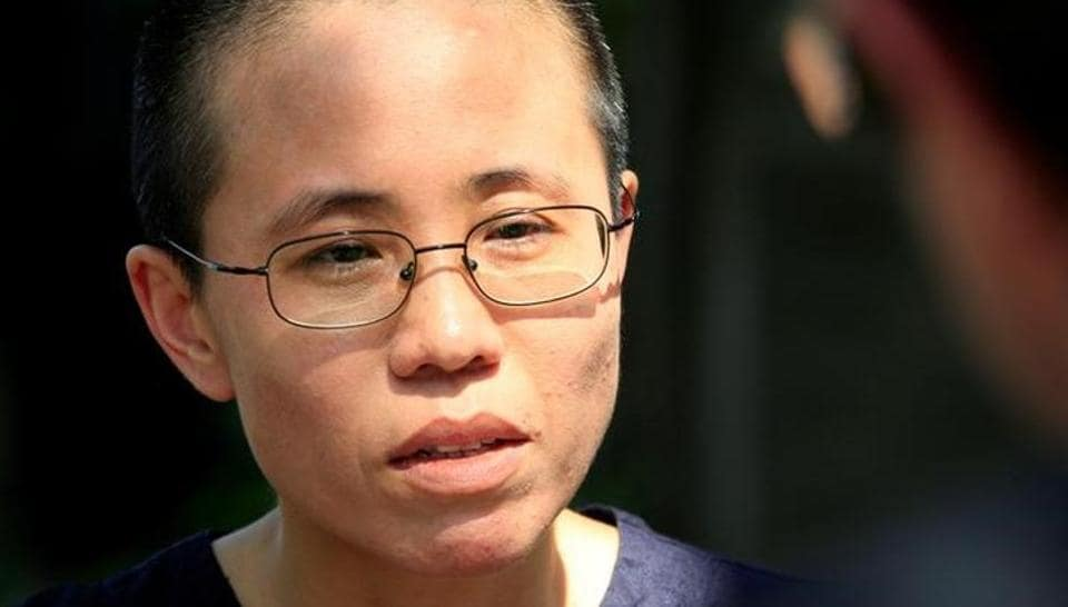 Liu Xia, wife of Chinese pro-democracy activist Liu Xiaobo, listens to a question during an interview in Beijing.