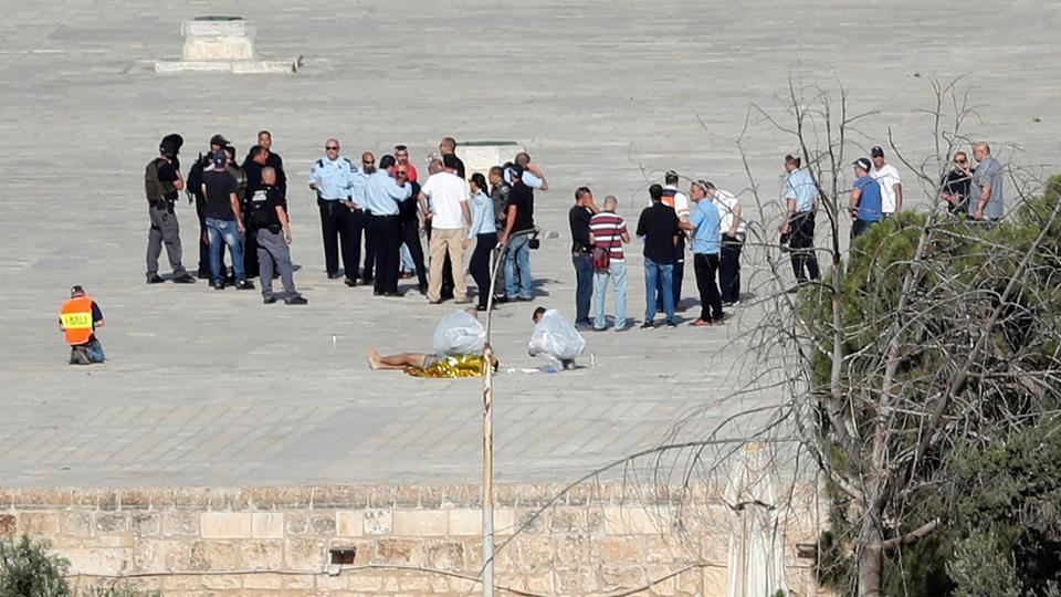 Israeli police check the scene where assailants fired shots in Jerusalem's Old City on Friday, July 14, 2017.