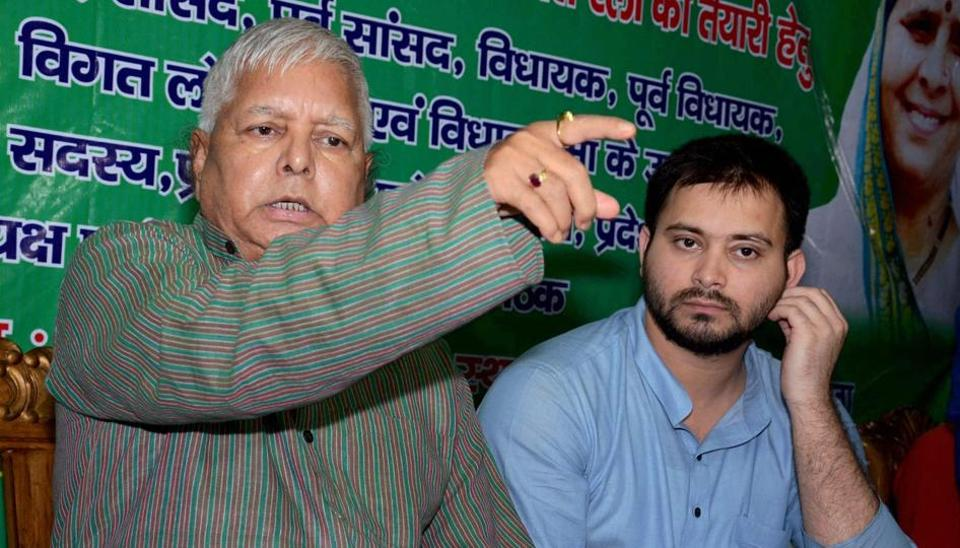 RJD chief Lalu Prasad addresses a press conference with his son and deputy CM Tejashwi Yadav at his residence in Patna after CBI raids at his premises.