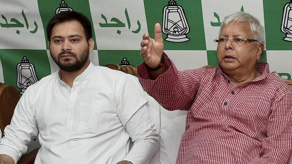RJD Chief Lalu Prasad with Tejaswi Yadav during a legislative party meeting in Patna.