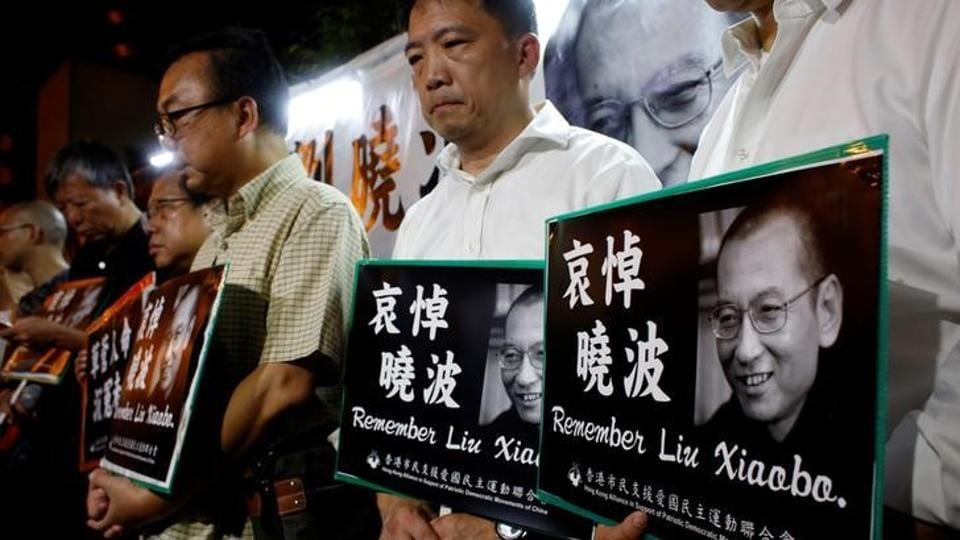 Pro-democracy activists mourn the death of Chinese Nobel Peace laureate Liu Xiaobo, outside China's Liaison Office in Hong Kong, China, on Thursday.