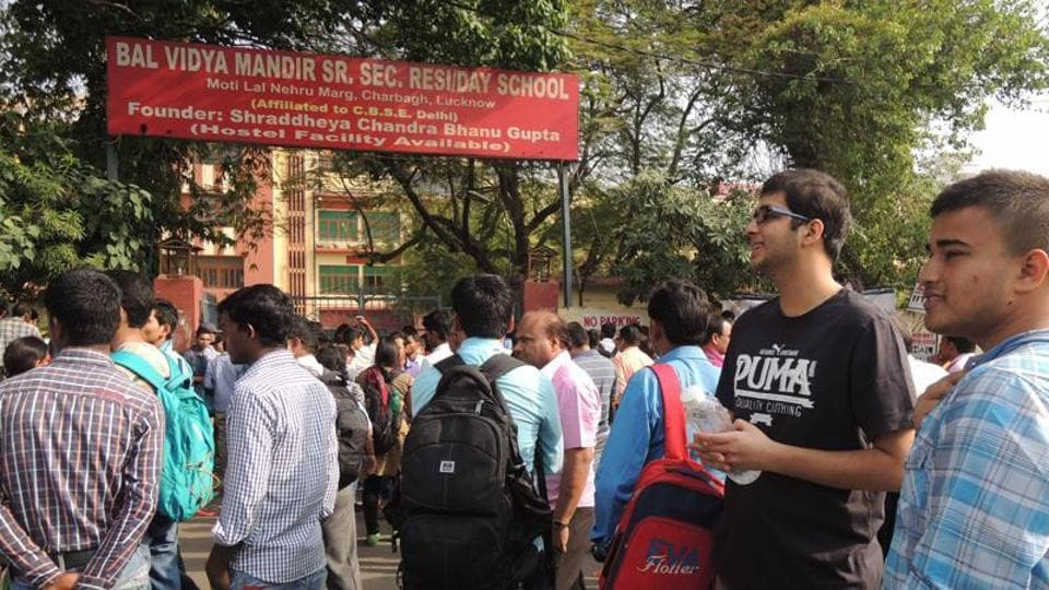 Students arriving at exam center to take JEE exam.