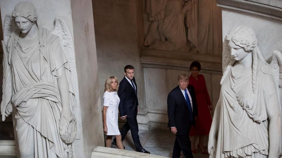 Emmanuel Macron (2nd L) and his wife Brigitte (L) tour Napoleon's Tomb with Donald Trump (2nd R) and Melania Trump (R) at Les Invalides museum in Paris, France. Touring the location Trump segued from to speaking on France's rich cultural heritage and remarked to Brigitte Macron, 'You're in such good shape.' (Ian Langsdon / Reuters)