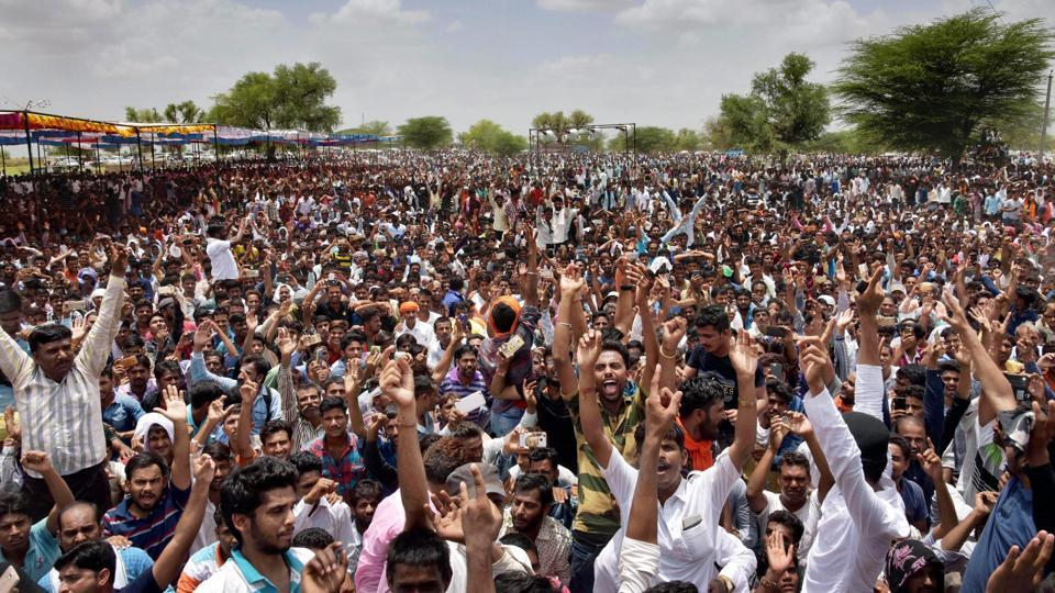 People raise slogans at a rally to pay tribute to slain gangster Anandpal Singh at Saanvrad village in Nagaur on Thursday.