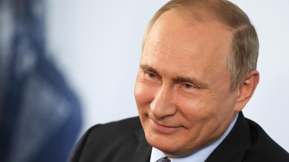 Russian President Vladimir Putin gestures while speaking to the workers of the Lebedinsky GOK JSC, in Gubkin, Belgorod Region, Russia, July 14, 2017.