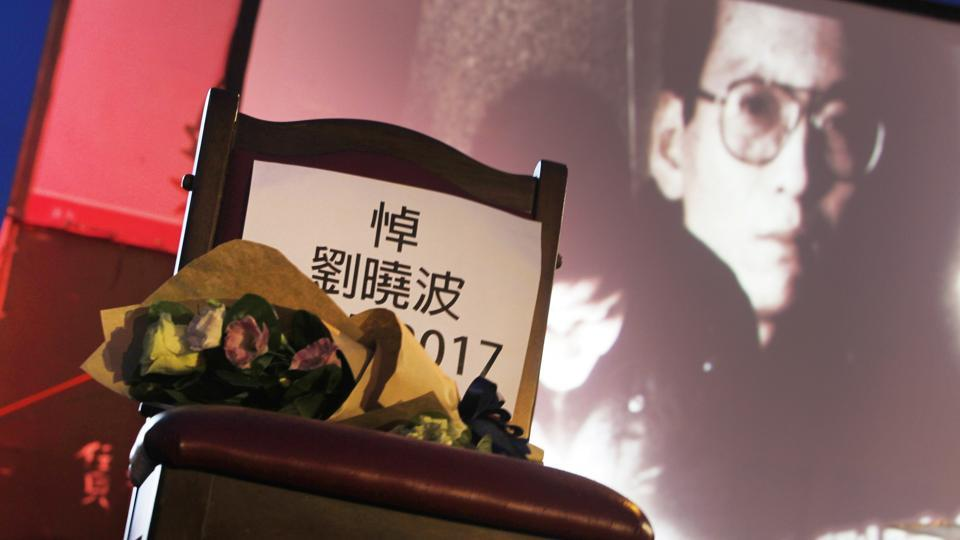 A bouquet of flowers is placed on a chair, which reads ''Mourning Liu Xiaobo'', in front of his image during a ceremony to mourn the late Nobel Peace Prize laureate, China's most famous political prisoner, at Democracy Square in Taipei, Taiwan on July 14, 2017. Liu died on Thursday of liver cancer at 61.