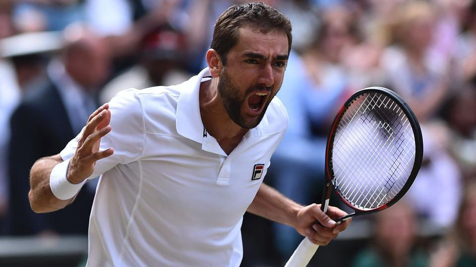 Croatia's Marin Cilic celebrates after winning against American Sam Querrey to enter the men's singles final  at Wimbledon 2017.