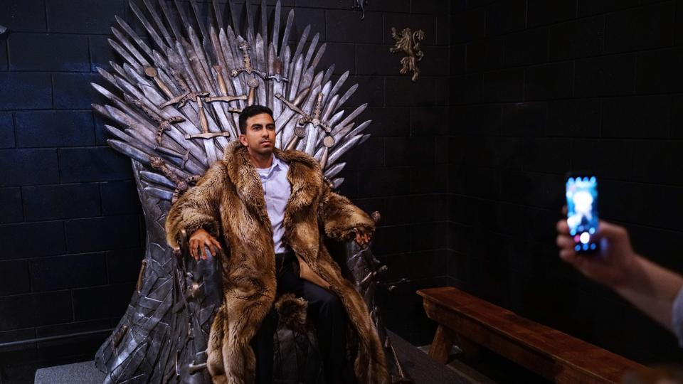 A man poses for a photo on the Iron Throne at the Game of Thrones pop-up bar in Washington DC, US.