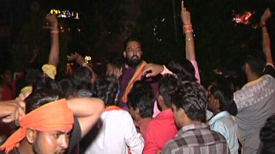 Bajrang Dal activists raise slogans after their leader, Kamlesh Thakur, walks out of Habibganj police station in Bhopal around 1 am on Friday.